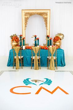 Style File: Queen of the Nile | WedLuxe Magazine. Teal, orange, gold.
