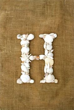 "sea shell letter ""H""  Love this on a scrap of beach wood"