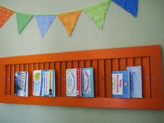 Shutter turned sideways becomes children's book display for thin books such as Little Golden...