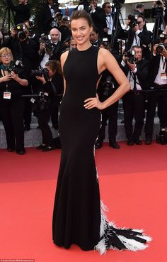 Black beauty:Russian beauty Irina Shayk dazzled in a glimmering backless gown with a spiderweb like design extending across the otherwise bare back. The dress looked relatively simple from the back, before she underwent a big reveal