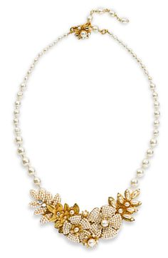 This Miriam Haskell vintage style necklace is made with seed pearls and guilt gold leaves. Each bead, crystal, and pearl is picked up by hand, and hand-wired to an intricate brass filigree backing.  Miriam Haskell jewlery was worn by the glamorous Hollywood elite from the 40's and 50's.  While this necklace is not a vintage piece it is made in the style of a by gone era.