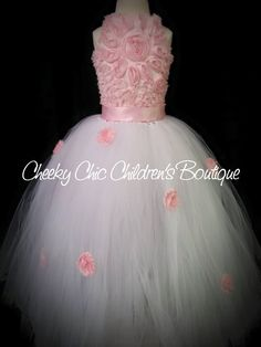 Pink corset style flower flower girl tutu dress. Tutu skirt is embellished with pink shabby flowers.