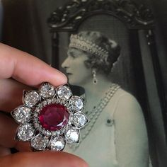 A Queen and her brooch. This ruby and diamond brooch once belonged to Queen Victoria Eugenia of Spain and her grand-mother, Queen Victoria of England. Perfect 19th Century brooch with a perfect provenance.