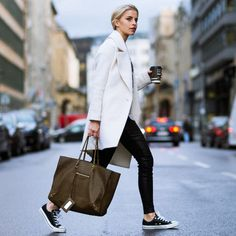 We love this look! Converse sneakers, leather trousers, a white coat, and a gorgeous brown Balenciaga bag.  #converse #sneakers #leather #trousers #whitecoat #balenciaga #bag #coffee #street #fashion #style