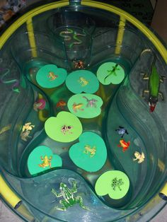Frog Pond Water Table! I added various small frogs, snakes, lizards and a crocodile to our small sensory table. I cut green craft foam into lily pads, which turned out really great! Awesome activity to do in Spring when talking about frog's life cycle!