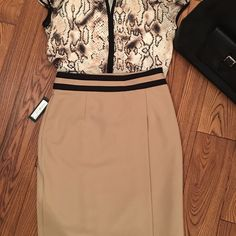 Tan wrap skirt NWT Worthington black & tan wrap skirt. Size 6 Worthington Skirts Midi