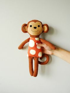 This adorable monkey is made of a high quality cotton fabrics and felt. Stuffed with non-allergenic polyester fiber. The face is carefully hand