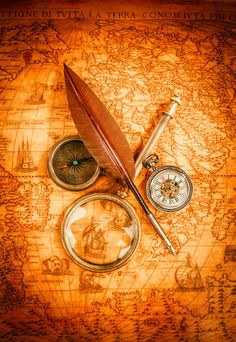 Vintage magnifying glass lies on an ancient world map by Andrey Armyagov - Photo 139595907 - 500px