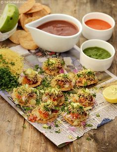 An arrangement of puris or papdis loaded with potatoes and chutneys, garnished with crispy sev and peppy coriander, Sev Puri is a snack worth many accolades! Indian Snacks, Indian Food Recipes, Vegetarian Recipes, Healthy Recipes, Healthy Snacks, Indian Appetizers, Easy Recipes, Brunch Recipes, Snack Recipes