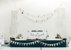 Hula hoop chandeliers can be easily made. Hula hoops, strips of old sheets or fabric, twine, and some glue!