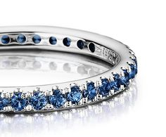Sapphire Eternity Ring in 18k White Gold highlighting the brilliant blue that comes to mind when you think of sapphires.