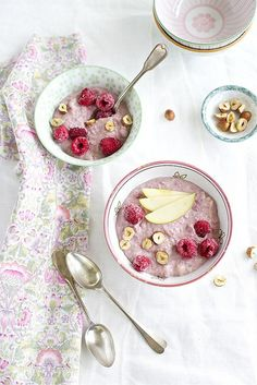 Beautifully pale pink hued Homemade Breakfast Muesli with Raspberries and Hazelnuts. #raspberries #cereal #breakfast #muesli #food #brunch #pink #beautiful