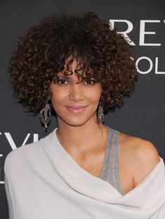 Halle Berry wore her gorgeous glossy mane of voluminous curls with minimal styling at a Revlon event.