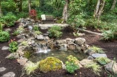 A private retreat nestled within an outdoor living space - a sanctuary patio away from the living environment - surrounded by natures finest - for tranquil moments of reflection - (water feature, flagstone patio, stone pathway, native plant...