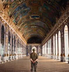 """""""A Yank in Versailles"""" Pvt. Gordon Conrey of Milford, N.H., one of the first Americans to visit Versailles (place of WW1 peace treaty) after its liberation from the Germans in 1944, standing in the hall of mirrors."""