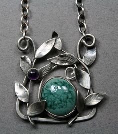 hand patterned sterling silver vines surround a pottery cabochon accented with a semi-precious stone. Hanging on a chain, which can be made to your choice of length Heart Jewelry, Jewelry Art, Jewlery, Silver Jewelry, Jewelry Necklaces, Metal Clay, Handmade Sterling Silver, Jewelry Branding, Vines