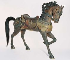 American Carosel Horse With lowered Head - Fabulous quality, by Charles Carmel (1865–1931)  Coney Island, Brooklyn, New York  c. 1914. Paint on wood with jewels, glass eyes, and horsehair tail. Measures 58 5/8 x 63 x 14 7/8 in.