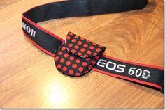 Camera lens cap pouch that slides onto your strap.