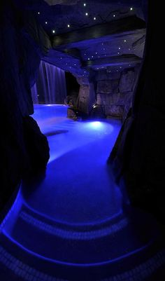 Indoor blue LED lit night cave swimming pool! Batman would be SO freaking jealous of this thing!