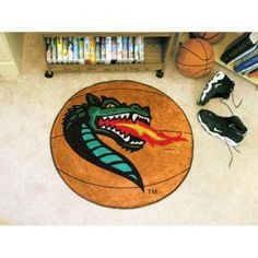 """Alabama Birmingham Blazers NCAA Basketball"""" Round Floor Mat (29""""). Each Fan Mats product is produced in a 250;000 sq. ft. state-of-the art manufacturing facility. Only the highest quality; high luster yarn with 16 oz. face weight is used. These mats are chromo jet printed; allowing for unique; full penetration of the color on the machine washable non-skid Duragon latex backing with a sewn edge  - making for a beautiful and lasting piece for even the most aggressive fan.  Anything else would…"""