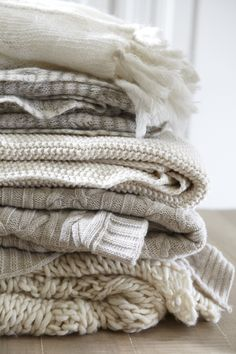 "A fashion staple comes home! This chunky, open-weave knit throw is as cozy as your favorite winter sweater with a soft wool blend that's comforting, and always """"in."""""