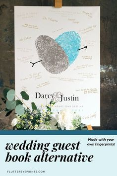 This contains: Wedding guest book alternative canvas on easel with guest signatures and made with couple's fingerprints