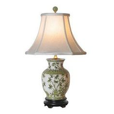      Vase lamp.   Features a hand-painted finish and a palm tree de...