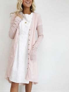 930. Roolee long cardi (I have this) with white dress and gold circle pendant necklace.