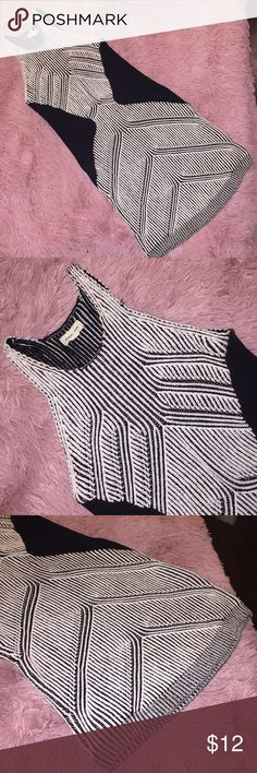 UO black + white sleeveless sweater dress! Beautiful black + white sweater dress from Urban Outfitters! Curve hugging with geometric detailing. Size M and only worn 2-3 times! Urban Outfitters Dresses Mini