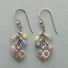 CHARM & HEART EARRINGS - Sapphires of every hue fall around a stamped sterling silver heart in earrings with considerable charm. Sterling silver wires.