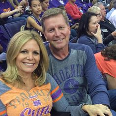 WWE executive John Laurinaitis and his fiance Kathy Colace attending a Phoenix Suns basketball game. Colace is the mother of WWE Divas the Bella Twins; Nikki Bella and Brie Bella. #TotalDivas #wwecouples