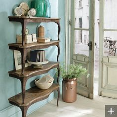 Wall Shelves: Can be purchased, but seems like an easy DIY if you were to cut a table in half, secure to wall, and stack it.