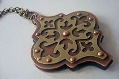 Kerdan - Tile In Translation - Pierced and Riveted Brass and Copper Pendant via Etsy