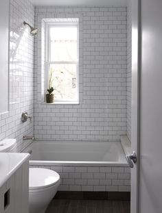 Subway tile bathroom. This one has dark grout - which I don't think is so good for your place