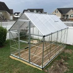 Two of us set this greenhouse up in about six hours time with a few breaks (it was muggy). Used a 4x4 foundation secured with anchor bolts to cement blocks in the corners. Assembly was not to bad. Pre-read the full instructions before assembly to understand each instructional step. Fully tightened all nuts at end and used level to plum up sides and to make sure door was clean fit. Great design of extruded aluminum and all attaching parts. Polycarbonate Greenhouse, Polycarbonate Panels, Anchor Bolt, Roof Vents, Greenhouse Ideas, Panel Systems, Extruded Aluminum, Outdoor Storage, Cement