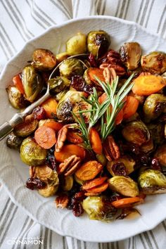 Super easy roasted Brussels sprouts and carrots, perfect for the holidays - Thanksgiving and Christmas. Naturally healthy and gluten free too! Find the recipe on NotEnoughCinnamon.com