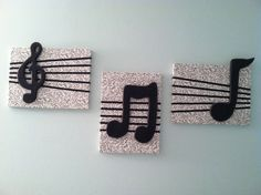 DIY wall decor- Cover canvas squares with music note fabric, add black ribbon, glue black spray painted wooden music notes, and voila!