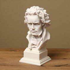 This handcrafted Beethoven bust is carved out of white bonded marble by artisans in the United States. The intensity of the expression on the German composer's face creates a stunning piece that you can proudly display in your home or office.
