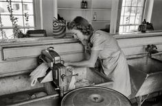 A woman hard at work doing the laundry with an old-fashioned ringer washing machine. #vintage #1930s #1940s #homemaker #housework