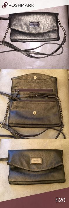 Nine West Wristlet/Crossbody Bag Nine West small Crossbody bag. It comes with a detachable strap and turns into a wristlet Excellent used condition. A picture of the lining is included. Nine West Bags Clutches & Wristlets