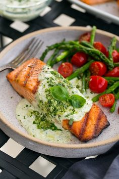 Salmon is grilled to perfection and topped with a rich and creamy pesto sauce. Definitely worthy of adding to the dinner rotation!
