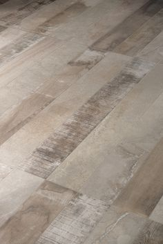 Inessence by Provenza, a mix of recycled wood and stone-cement looks.