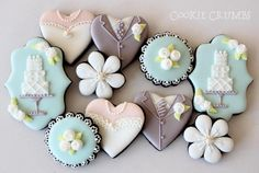 Wedding Themed Chocolate Cookies with Royal Icing; Wedding Cake, Bride and Groom and Flowers.