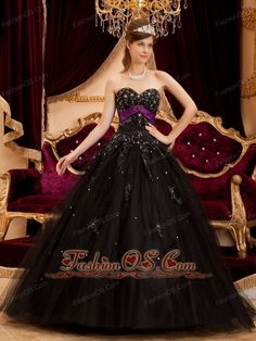 Wonderful Black Quinceanera Dress Sweetheart Tulle Appliques Ball Gown  www.fashionos.com  So gorgeous this black quinceanera dress is!The whole bodice is encrusted with a sweetheart neckline and the exquisite appliques.A dainty waistband reveals your slim figure and natural waistline completely.The floral embellishment in the middle section and the luminous spot makes the skirt to create a beautiful shape.A lace up closure completes this wonderful dress.