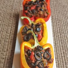 Paleo Stuffed Peppers Recipe Main Dishes with yellow onion, garlic, olive oil, ground beef, ground cumin, dried parsley, smoked paprika, sea salt, ground black pepper, diced tomatoes, jalapeno chilies, black olives, bell pepper
