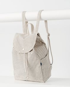 A simple canvas satchel for daily essentials. Roomy, but still neatly sized. **** 10.5 in. W x 15 in. H x 5 in. D. Two adjustable straps. One interior and two exterior side pockets. 100% 16 oz. recycl