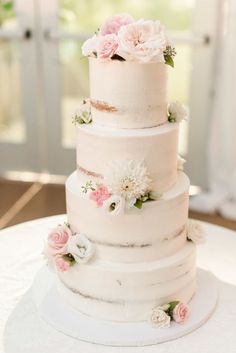 Four tier naked wedding cake topped with dahlias: http://www.stylemepretty.com/new-jersey-weddings/gladstone-new-jersey/2017/03/08/blush-gold-golf-club-wedding/ Photography: Christy Nicole - http://christynicole.com/
