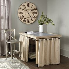 This versatile Storage Table works as casual island, a crafting table or extra workspace in the office. The generous counter height top has a smooth, composite blue stone inset that's great for crafting, arranging flowers or wrapping packages. Open area beneath is spacious enough to conceal a large dog crate or two smaller ones. Grommeted panels keep everything out of sight. Barclay Storage Table features: Substantial hardwood frameStone composite inset topIncludes 4 linen-cotton…