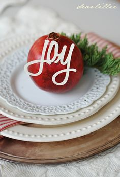 Christmas table setting- This would be so cute to write names on the ornaments!