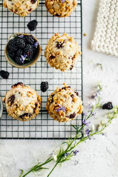 An easy recipe for blackberry rhubarb muffins. This muffin recipe is filled with tarty blackberries, rhubarb chunks and laced with cinnamon. On top is an oat crumble that makes for the most perfect salty-sweet bite! These muffins are great for brunches, Easter brunch, Mother's day and all of your spring gatherings!